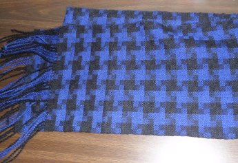 Black and blue Carol Strickler draft project from Weaving Today, woven in Jaeger Spun at 24 epi