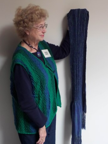 Virginia R - Woven shibori scarf in 8/2 variegated tercel warp and 8/2 navy tercel and navy polyester sewing thread weft