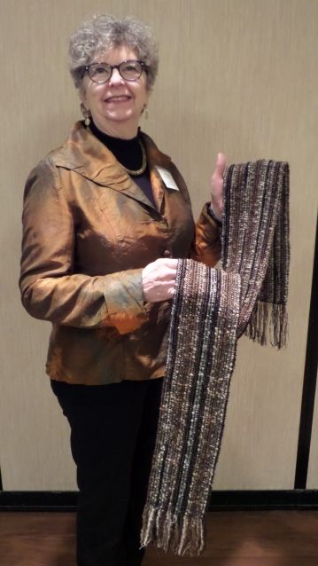 ChrisM - Black/brown/gray scarf made with wool boucle, cotton, and Tencel using grouped warp threads
