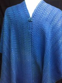 """Ellen GB - """"Ocean Waves"""" ruana, woven in 8-shaft undulating twill with 8/2 cotton and laceweight silk, sett at 20 epi, shown here from the back highlighting button and seam detail."""