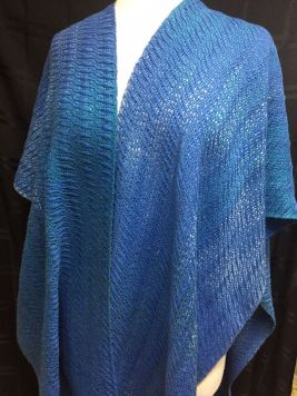 """Ellen GB - """"Ocean Waves"""" ruana, woven in 8-shaft undulating twill with 8/2 cotton and laceweight silk, sett at 20 epi, shown here as a wrap, shown here unwrapped from the front."""