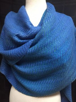 """Ellen GB - """"Ocean Waves"""" ruana, woven in 8-shaft undulating twill with 8/2 cotton and laceweight silk, sett at 20 epi, shown here as a wrap."""