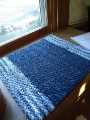 """Jennifer J - Rosepath mat woven with 4-shaft pattern from Tiaa Ignell's """"Favorite Scandiavian Projects to Weave (2010),"""" using 8/4 cotton, Bernat blanket acrylic """"plush"""" yarn, and Lion brand Wool-Ease Thick & Quick yarn, sett at 8 epi."""