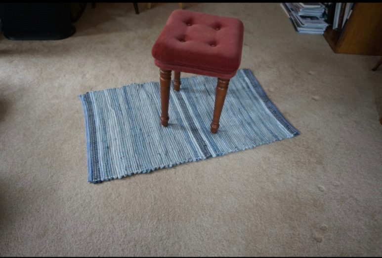 Andrea A - Rag rug woven with strips from blue jeans and other fibers.