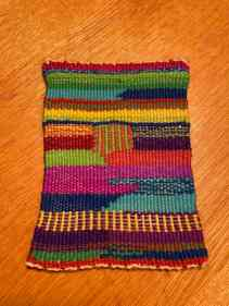 Suzanne W - Tapestry sampler woven on Mirrix Saffron loom using materials provided for Mirrix Weave-Along. Instructions called for doubled warp and 2 plies of weft, which did not provide optimal warp coverage. A fun project even if the results were less than ideal.