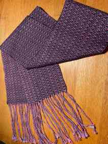 Suzanne W - Finished scarf from Tien Chiiu's and Janet Dawson's Stash Buster Scarf weave-long. woven in 2/2 twill on 4 shafts with 5/2 cotton sett at 20 epi.