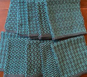 Bev A - Breadcloths/napkins made in 4/2 cotton in black and turquoise using 4-shaft shadow weave, sett at 12 epi.
