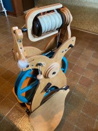 """Bev A - Schacht spinning wheel with some of her handspun yarn from 2021 Ravelry """"Tour de Fleece"""" event. She and Chris M teamed up for this year's event, which featured 18 days of spinning."""
