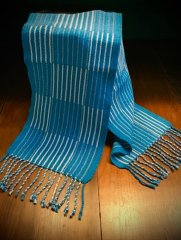 Chris M - Extended twill scarf woven in 10/2 perle cotton in natural and 4 shades of blue, in 4-shaft extended twill in color-and-weave, sett at 26 epi.