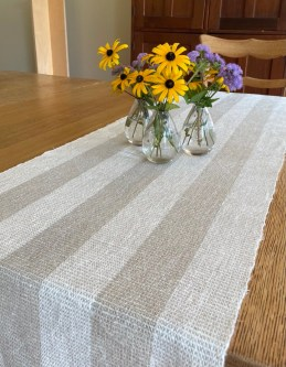 Gay A - Linen table runner woven in 10/2 linen using plain weave, sett at 15 epi. The weft alternates colors with each weft pass. The runner will be a wedding gift.