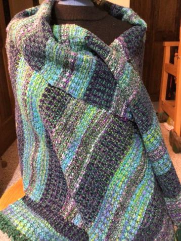 Linda A - Her long-languishing green warp, finally woven off into a lovely wrap!