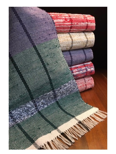 Chris M - Rag rugs woven on 4 shafts in plain weave using 8/4 cotton carpet warp sett at 12 epi and cotton rag strips for weft. The blue and green rugs use a fibonacci stripe sequence, as does the tan and yellow rug. The red rugs are more freeform.