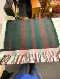 Elizabeth Q - Rug woven on 4 shafts using rug warp, sheet strips, and cordon knit rag coils, using a sett of 10 epi. She was unhappy with the finished piece, so she cut it off the loom and made potholders from it, shown elsewhere in this gallery.