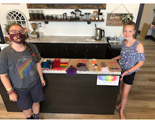 """Jody W - Graduates of her """"Tapestry Weaving Camp"""" with the weavings they created using cardboard looms and various yarns. Great work by weaving newcomers!"""