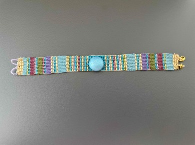 """Suzanne W - Bead and fiber woven bracelet from kit by Ann Benson on her """"No Finish Bead Loom."""" Woven in Tencel, nylon, and glass/metal beads."""