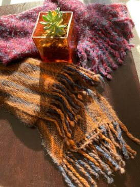 Virginia H - Twill scarves woven on 4 shafts. The maroon and blue one was woven with a DK-weight warp and similar weigh mohair as weft; the orange and blue scarf use DK-weight yarn in both warp and weft. The sett and beat were purposely a bit more open to facilitate drape.